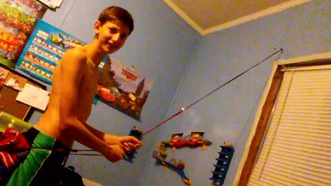 Kid Tries To Climb Wall With Stretchy Rope