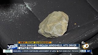 Rock smashes through car's windshield on I-5, hits driver in head