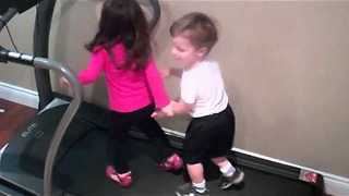 Siblings Having A Blast On The Treadmill Machine, Trying To Outrun The Track - Video