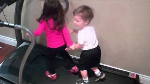 Little kids have a ball using treadmill