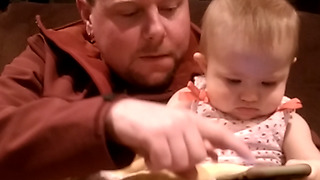 Adorable Baby Playing With Her Dad's Smartphone - Video