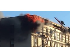 Fire Engulfs Top Floor of Manhattan Apartment Building - Video