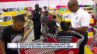 Police and firefighters take part in back to school shopping with a hero - Video