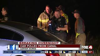 Vehicle lands head-first into Lehigh Acres canal after incident involving police - Video