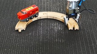 Robot Creates Train Track Loop - Video