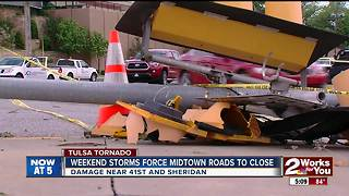 Cleaning up midtown after weekend tornado - Video