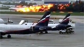 Plane catches fire, emergency lands in Moscow, 13 dead