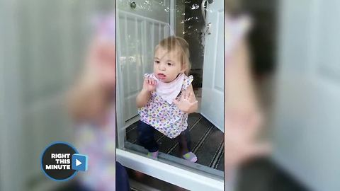 Baby Hams It Up Against The Glass