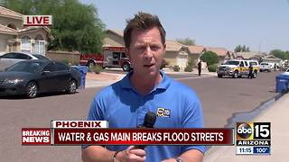 Water, gas line break floods Phoenix neighborhood - Video