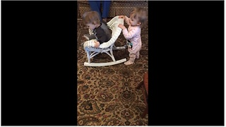 Baby girl pushes twin brother in rocking chair - Video