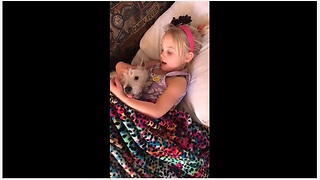Little Girl Tries To Send Her Pup To Dreamland By Singing A Lullaby - Video