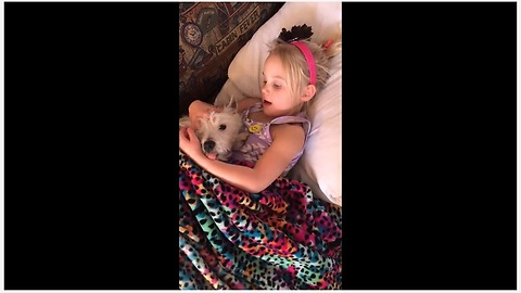 Little Girl Tries To Send Her Pup To Dreamland By Singing A Lullaby