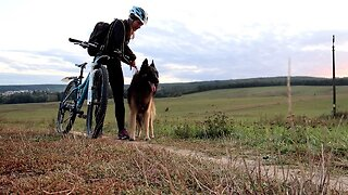 ENERGETIC DOG CAN'T HIDE EXCITEMENT WHEN HE GOES BIKE RIDING WITH OWNER