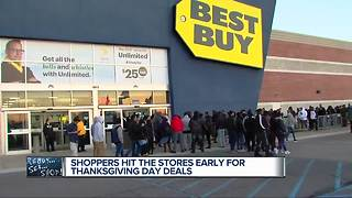 Hundreds brave the cold, lines for Black Friday - Video