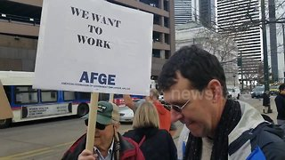 Federal workers protest government shutdown in downtown Denver - Video