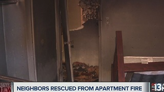 Occupants rescued from balcony above apartment that caught fire - Video