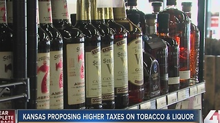 Kansas governor's budget fix: Higher taxes, tobacco funds