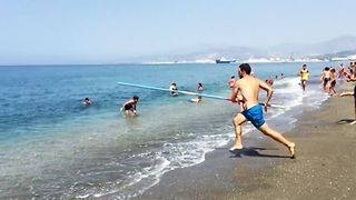 Brave Man Pole Vaults From the Beach Into the Ocean - Video