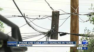 Phone and cable lines dangling in yards