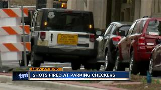 Shots fired at three Milwaukee parking checkers while on the job - Video