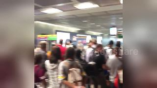 Passengers look uncertain as Frankfurt Airport terminal evacuated - Video