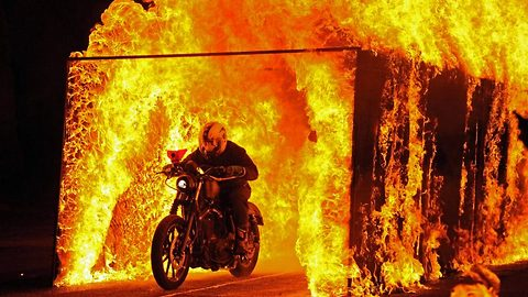 Insane daredevil pensioner set alight as he drives through tunnel of fire on a motorbike, in jaw droping stunt