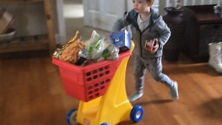 Cute footage of toddler helping mom with groceries