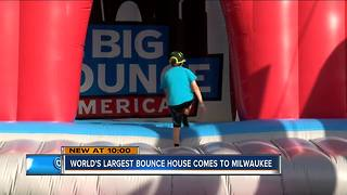 Biggest bounce house opens despite rain delay - Video