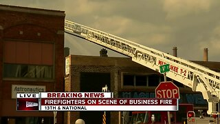 Firefighters on scene of business fire in Milwaukee