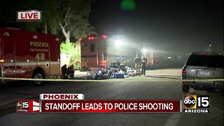 Robbery suspects exchange gunfire with Phoenix police, one in custody - Video