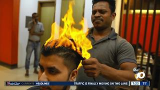 Fire used to cut hair? - Video