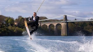 Bond fan arrives at his own wedding 007 style by wakeboarding to the ceremony  - Video