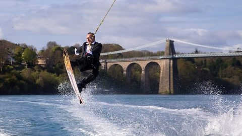 Bond fan arrives at his own wedding 007 style by wakeboarding to the ceremony