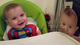 Too cute! UK baby giggles at cardboard cutout of baby - Video