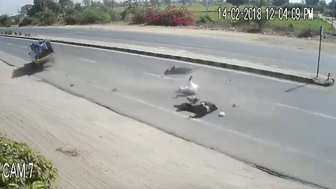 Horrific accident caught on camera: Indian family miraculously survives as speeding vehicle hits their bike on highway