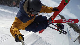 Thrill seeker skis off truck, stunts down slope and then skis back onto truck - Video