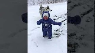 Cute Toddler Plays in the Snow for the First Time - Video