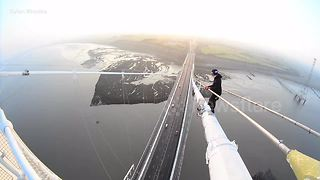 Heart-stopping moment daredevils climb to top of UK bridge - Video