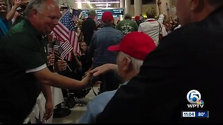 Hundreds gather at PBIA to welcome home veterans