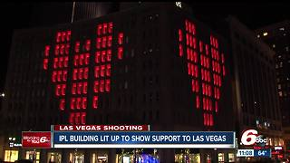 Building in downtown Indianapolis lit up to show support for Las Vegas - Video