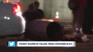 Tourist hurt by falling garbage can from parking ramp - Video