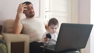 Baby makes dad's work from home impossible!