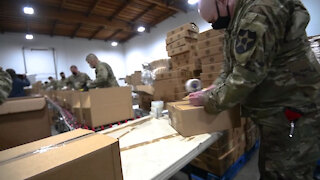 WA National Guard Soldiers prepare and distribute food