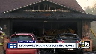 Man saves dog from burning house in Sun City West - Video