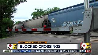 Stopped trains blocking railroad crossings - Video