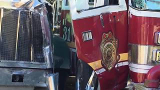 Three firefighters injured when stolen dump truck slams into fire truck - Video