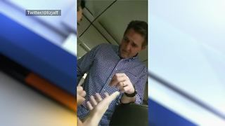 Sen. Jeff Flake talks tax reform bill with plane passenger - Video
