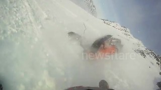 Dramatic snowmobile crash caught on GoPro camera - Video