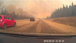 Traffic, Smoke Builds as People Escape Fort McMurray Fire - Video