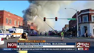 Buildings smoldering hours after a massive fire erupted in Wagoner - Video